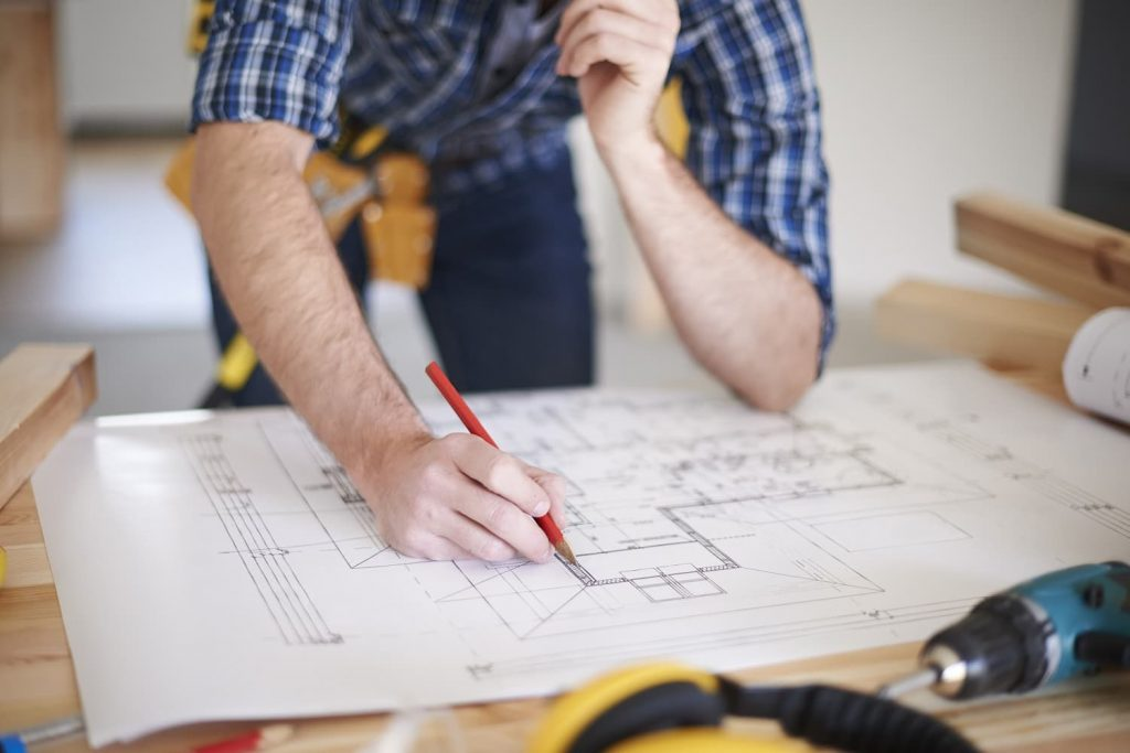 Contractor working on a house plan.